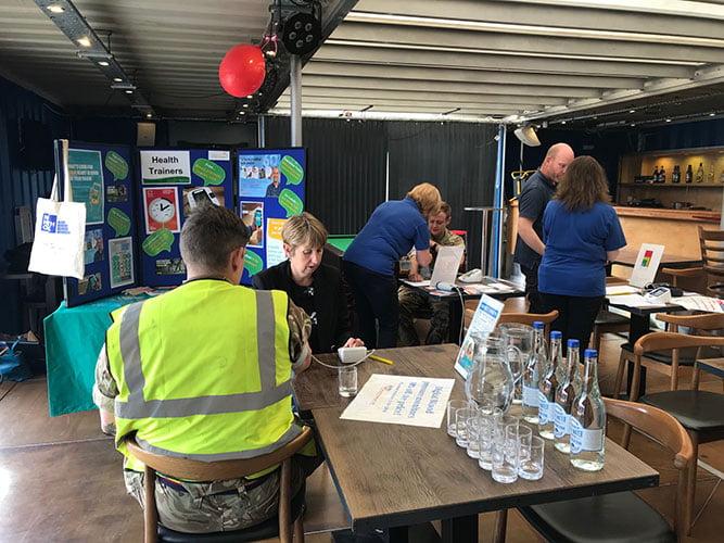 Drivers having blood pressure checks at Chippenham Pit Stop regular health check mornings