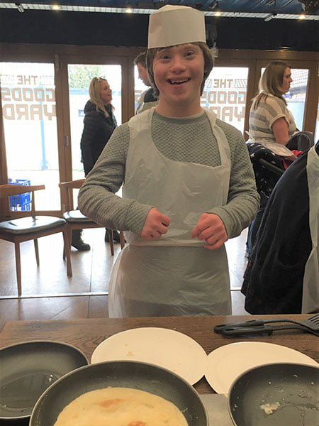 Ned from St Nicholas School celebrates pancake day at Chippenham Pitstop